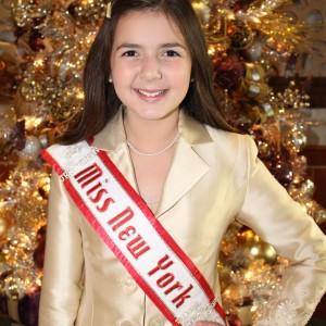 Annaliese Arena at our favorite Christmas tree at NAMNationals14. Poised, classic and confident in her Personal Introduction suit! Your 2014 National American Miss New York Jr. Pre-Teen!
