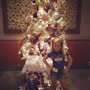 In front of the tree!!!love you Ava!!!