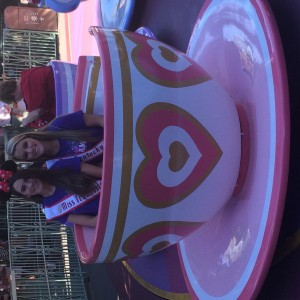 Teacup spinning at Day at Disney- Spencer Pett, 2014 Miss Tennessee Teen and Natalie Lawrenc, 2014 Miss Kentucky Teen
