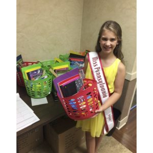 Cassidy Quinn, Miss Pennsylvania Pre-Teen, collected items to donate to a local youth group for her community involvement project