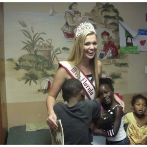 "Erika Stallings, Miss Florida Jr. Teen created ""Reading with the Queen"" through the Trinity Rescue Mission to read to unpriviledged children"