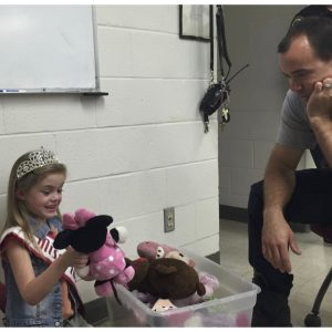 Kinsley Locke, Miss Florida Princess, donates her stuffed animals to the Tallahassee Fire Department