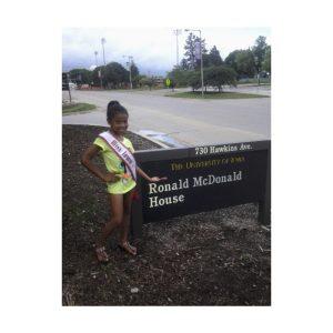 Miss Iowa Jr. Pre-teen Queen, Lemuel Carrol, volunteers at the Ronald McDonald House
