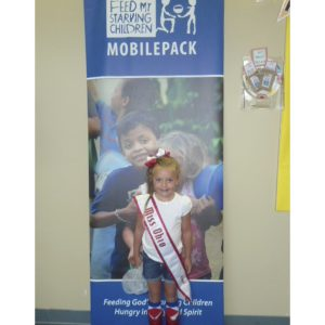 NAM Miss Ohio Princess, Kamryn O'Leary, volunteers at Feed My Starving Children