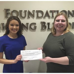 NAM National Finalist, Hailey Germano, presented check to Foundation Fighting Blindness after hosting a fundraiser to benefit VisionWalk and Foundation Fighting Blindness