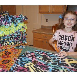National American Miss Arizona Finalist, Michaela Robbins, made fleece blankets for the Arizona Humane Society