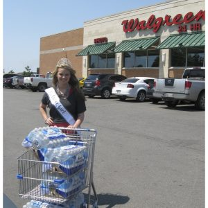 National American Miss Contestant, Brittney Helmert, collects water to donate to local firefighters in Oklahoma