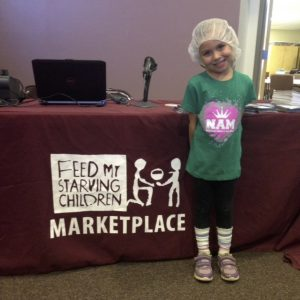 National American Miss Finalist, Alena Mascarena from Arizona volunteers with Feed My Starving Children