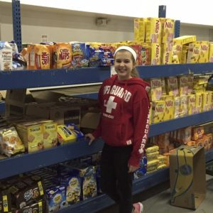 National American Miss Finalist, Emily Zawodny of Ohio, volunteers at the Northwestern Ohio Food Bank