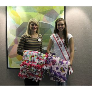 National American Miss Iowa Jr. Teen Queen, Hannah Bockhaus, makes fleece blankets for pediatric cancer patients