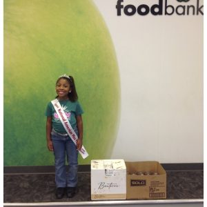 National American Miss State Finalist, Mykala Buchanan, gives back at the Houston Food Bank