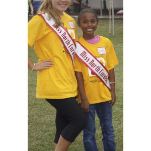 Niyah Smith and Alexandria Murphy, NAM North Carolina State Queens volunteer at the Light the Night Walk for the Leukemia and Lymphoma Society