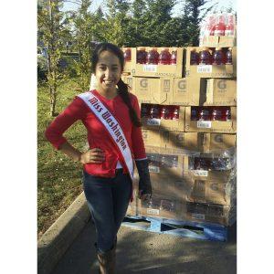 Novalee Lewis, Miss Washington Pre-Teen, volunteers at the Fish Food Bank