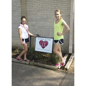 Stephanie and Brooke Heath, National American Miss Texas Finalists volunteer for Lunches of Love