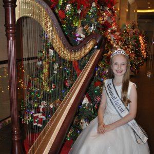 Megan playing Christmas carols in the hotel lobby