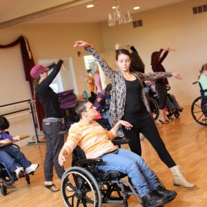Anna helping to teach adults with disabilities to dance.