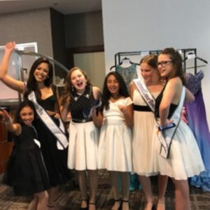 Alexa Serafin with former queens and fellow preteens